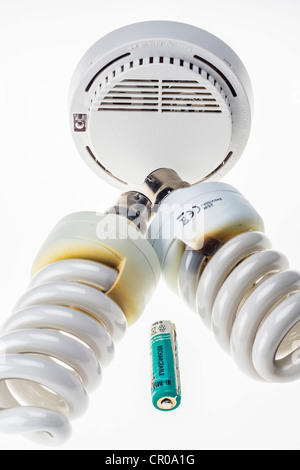 light bulbs showing scorched insulators before burnout failure, and rechargeable nickel metal hydride cell overcharged - Stock Photo