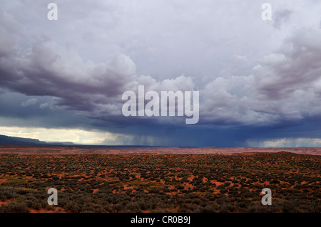 Monsoon thunderstorm over the Escalante Plateau, Grand Staircase Escalante National Monument, Utah, USA, North America - Stock Photo