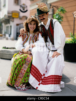 Hungary. Budapest. Couple posing outdoors in traditional costume. - Stock Photo