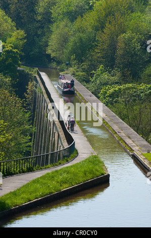 Narrow boat and walkers on Chirk Aqueduct carrying Llangollen Canal over Ceiriog Valley, Wales UK - Stock Photo