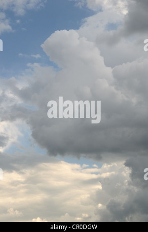 Cloudy sky full of deep grey thunder clouds on the sunset - Stock Photo