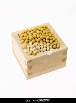 yellow soybeans in square box - Stock Photo