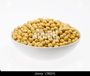 yellow soybeans in bowl - Stock Photo