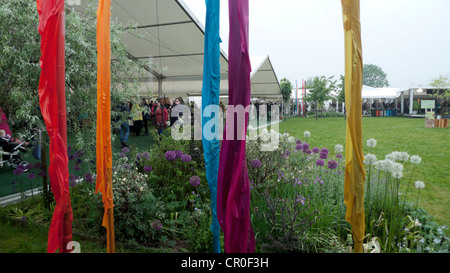 Soggy wet banners weighed down with water on the Hay Festival site Hay-on-Wye Wales 2012 - Stock Photo