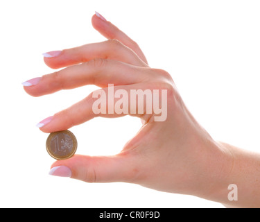 Female hand with one euro coin isolated on white background - Stock Photo