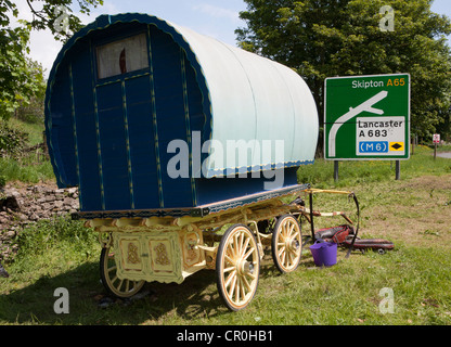 Travellers assembling for the Appleby Horse Fair_ Bow top traditional caravans and horse-drawn carriages and wagons. - Stock Photo