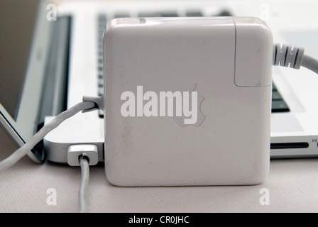 Apple MacBook Pro faulty T MagSafe power adapter MacBook fray frayed Mag Safe adapters cord cords separation between - Stock Photo