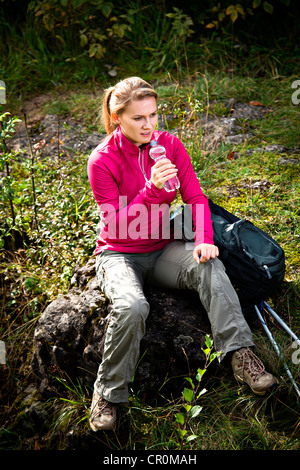 Young woman hiking in Dolomite Alps, Dolomites, Italy, Europe - Stock Photo
