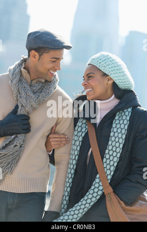 USA, New Jersey, Jersey City, Couple walking in winter clothes - Stock Photo