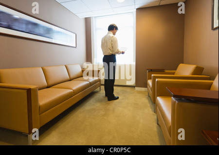 USA, New York, New York City, Businessman in office - Stock Photo