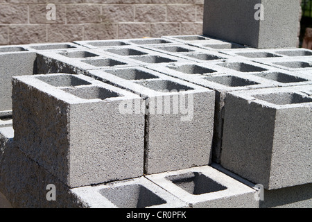Architectural concrete blocks stacked at a construction site. - Stock Photo
