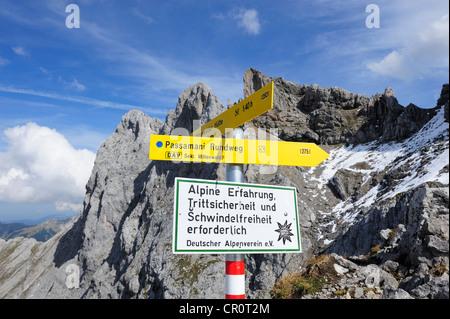 Signposts for the Passamani hiking trail in the Karwendel mountain range, Karwendel Alpine Nature Park near Mittenwald - Stock Photo