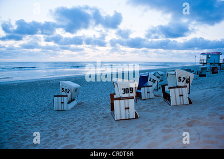 Roofed wicker beach chairs, Sansibar, Sylt Island, North Frisian Islands, Germany, Europe - Stock Photo