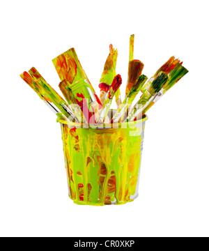Paint brushes in the colorful bucket on white background - Stock Photo