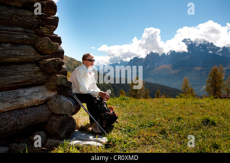Woman hiking in Drei Zinnen, Tre Cime di Lavaredo area in Dolomite Alps, Southtirol, Italy, Europe