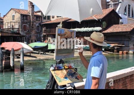 Artist painting en plein air, Venice, Italy - Stock Photo