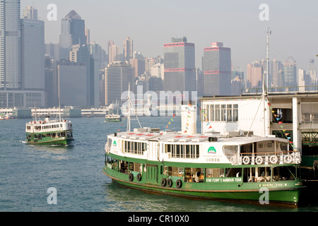 China, Hong Kong, Star Ferry Pier, ferries with Central District in the background - Stock Photo