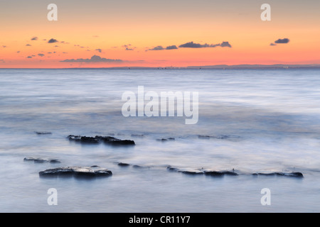 Rocks surrounding by incoming tide at Lilstock Beach, Somerset, UK. - Stock Photo