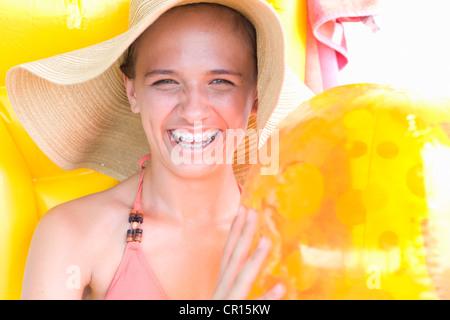 Teenage girl in braces wearing sunhat - Stock Photo