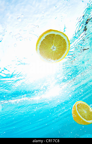 Lemons floating in swimming pool