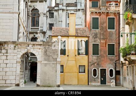 Italy, Venezia, Venice, listed as World Heritage by UNESCO, small yellow house - Stock Photo