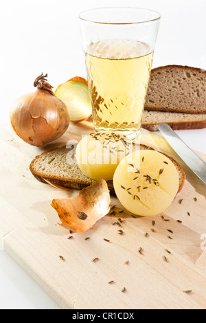 Traditional food of Frankfurt, German hand cheese or Harz cheese with caraway, an onion, rye bread and a glass of - Stock Photo