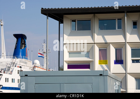Modern prefab student housing in the Amsterdam harbour, harbor, docklands, using modular cargo shipping containers.