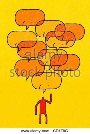Smiley face speech bubbles over man - Stock Photo