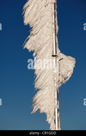 Ice-covered flagpole, Zugspitze Mountain, Bavaria, Germany, Europe - Stock Photo