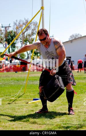 Sheaf Toss at the Scottish Festival Orange County Fairgrounds Costa Mesa, California. - Stock Photo