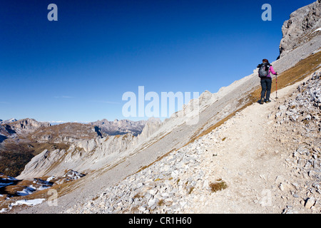 Hiker ascending the Bepi Zac climbing route in the San Pellegrino Valley above the San Pellegrino Pass - Stock Photo