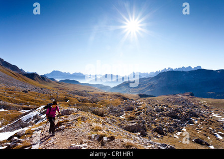 Hikers heading to the Bepi Zac via ferrata in the San Pallegrino valley, above San Pellegrino Pass or Passo San - Stock Photo