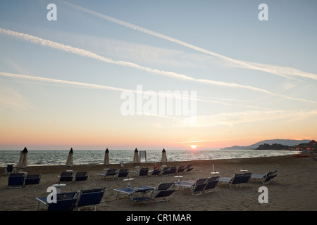 Lawn chairs in rows on beach - Stock Photo