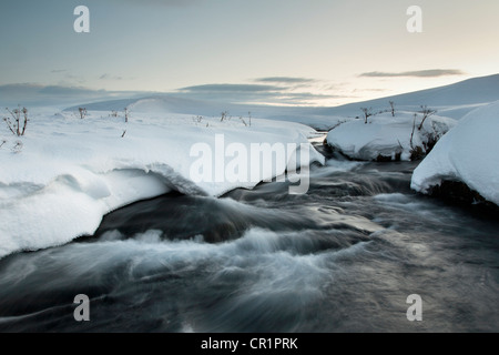 Time lapse view of glacial hot spring - Stock Photo