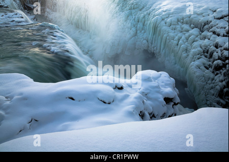 Steam rising from glacial hot spring - Stock Photo