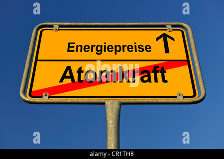 City limits sign with the words Energiepreise and Atomkraft, German for energy costs and nuclear energy, symbolic - Stock Photo