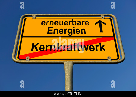 City limits sign with the words erneuerbare Energien and Kernkraftwerk, German for renewable energy and nuclear - Stock Photo