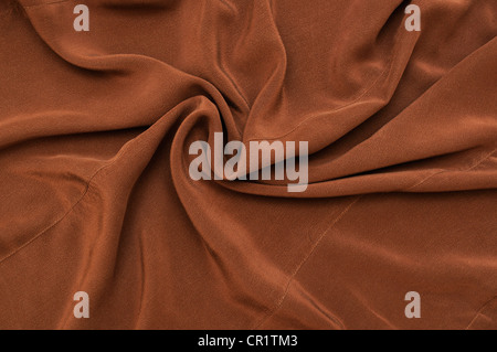 Drape background of brown silk - Stock Photo