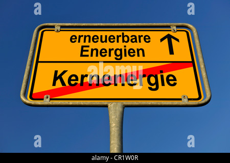 Symbolic image in the form of a town sign, in German, exit from nuclear energy, entrance into renewable energy sources - Stock Photo
