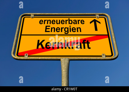 Symbolic image in the form of a town sign, in German, exit from nuclear power, entrance into renewable energy sources - Stock Photo