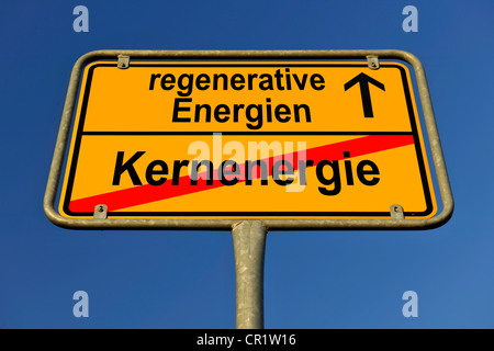 Symbolic image in the form of a town sign, in German, exit from nuclear energy, entrance into regenerative energy - Stock Photo