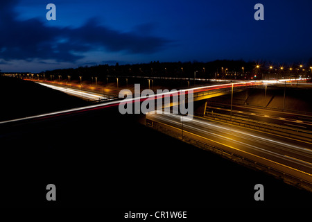Time lapse view of traffic at night - Stock Photo