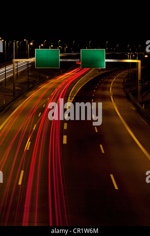 Time-lapse view of traffic on highway - Stock Photo