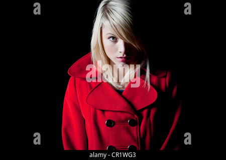 Woman wearing red coat outdoors - Stock Photo