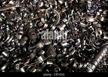 Steel shavings in steel forge - Stock Photo