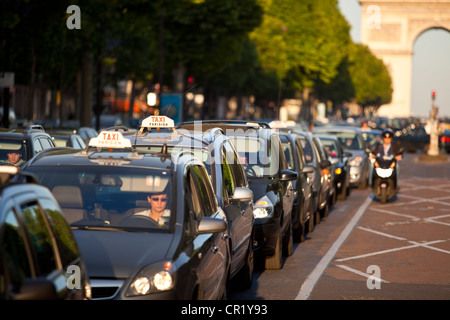 France, Paris, taxi queue on avenue des Champs Elysees - Stock Photo