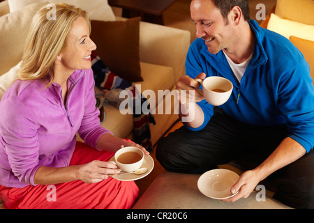 Couple having cup of coffee together - Stock Photo