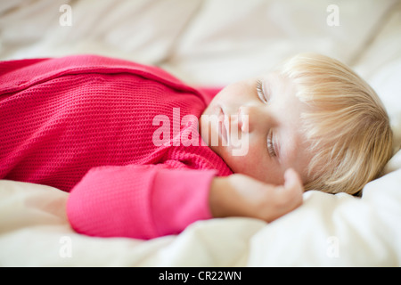 Portrait of baby girl (18-23 months) sleeping - Stock Photo