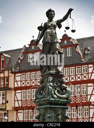 Ornate fountain with statue in square - Stock Photo