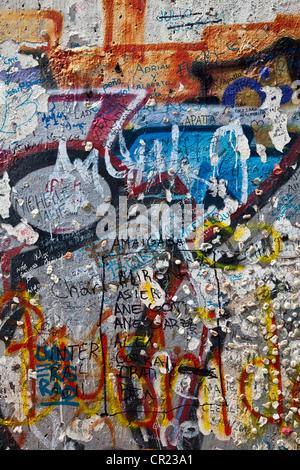Close up of graffiti on Berlin Wall - Stock Photo